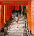 Girl jumping through Torii Gates
